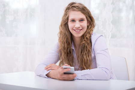online safety: Image of happy responsible teenager with new cellphone