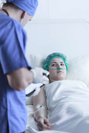 upcoming: View of a doctor preparing patient for upcoming surgery