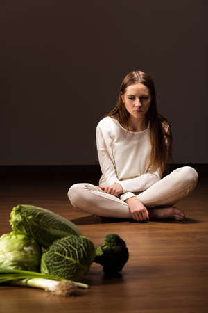 starving: Photo of young starving female with mental problem