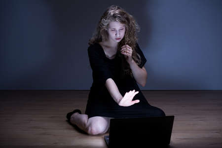 harassing: Photo of sad girl standing up to cyber violence