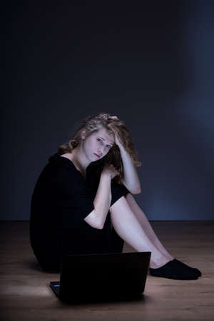 harassing: Picture of depressed blonde woman humiliated on internet