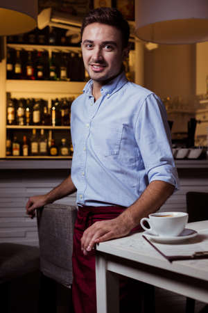 Photo of handsome male restaurant staff member at work Stock Photo