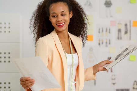 afroamerican: Photo of afroamerican enterpreneur during work in agency