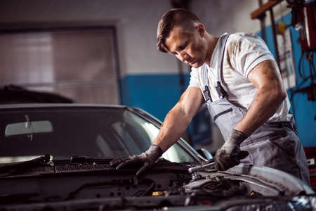 muscled: Muscled focus car mechanic repair the car