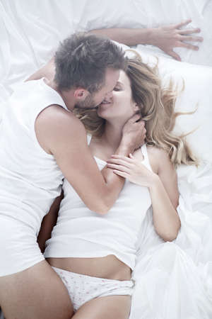 romantic couples: Image of couple during passionate foreplay in bed