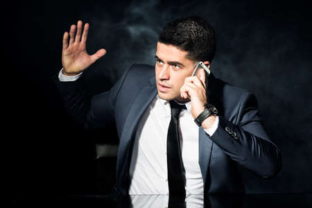 irate: Photo of irate employer during phone business conversation Stock Photo