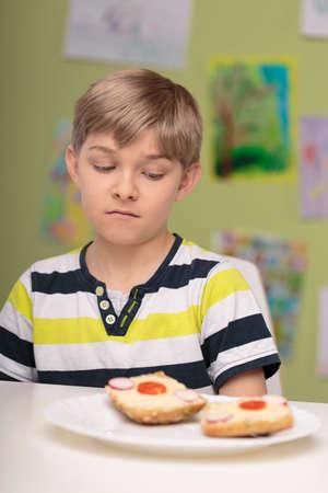 eater: Photo of small picky eater boy dislike healthy breakfast