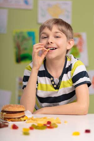 caloric: Image of boy having unhealthy caloric diet