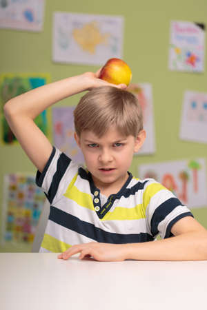 pouty: Picture of pouty boy refuting healthy food Stock Photo