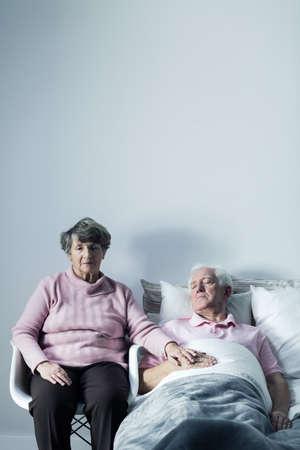 elderly woman: Image good wife supporting elderly mortally ill husband