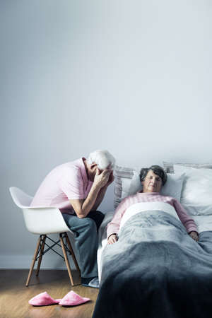 mortally: Image of despair husband and his dying wife