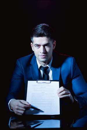 respecting: Image of elegant man holding business formation agreement Stock Photo