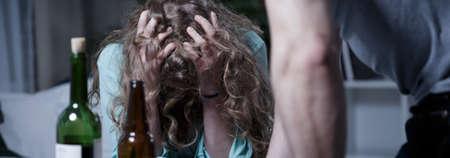 broken down: Broken down young woman bullying by husband Stock Photo