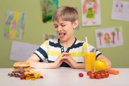 hungry kid: Photo of small picky eater and his diet