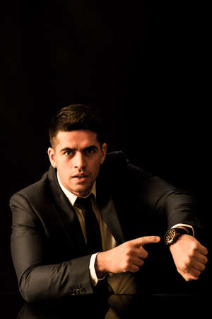 employer: Picture of angry employer in suit with wristwatch