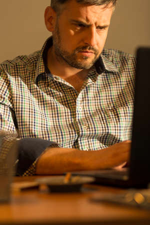 busy beard: Man concentrated on his work on the laptop