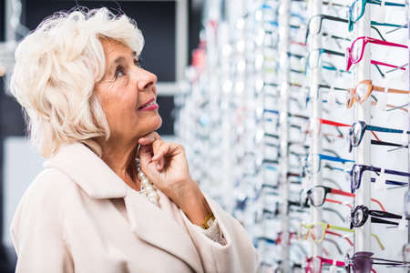 corrective: Image of senior woman searching for corrective glasses