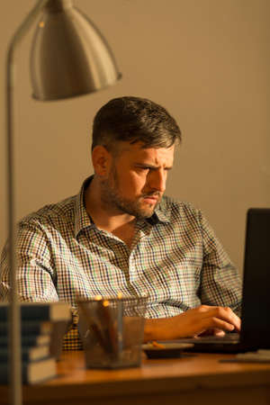 home business: Man working on urgent project from home Stock Photo