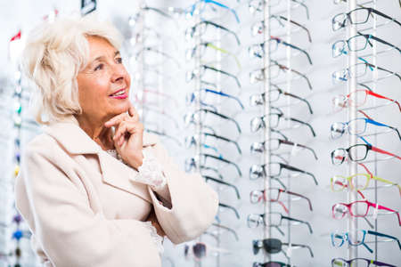 optical: Image of smiling elderly woman at optical shop