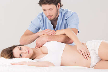 physiotherapists: Young pretty pregnant woman at physiotherapists office