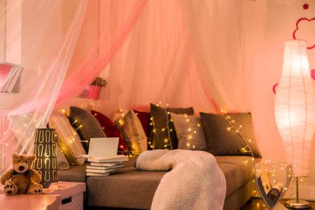 teen bedroom: Fairy lights and baldachin in teen bedroom