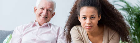 younger: Elder man likes spending time with younger people Stock Photo