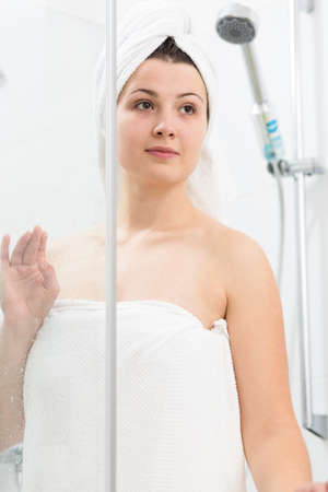 showering: Beautiful woman covered in towel after shower
