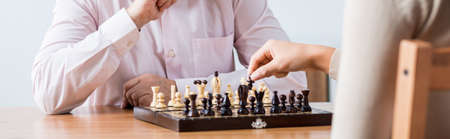 trusted: Trusted doctor is playing chess with elder man