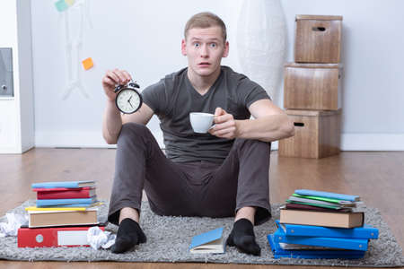 prepare: Image of stressed student holding alarm clock and coffee