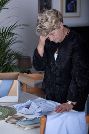 Picture of elderly gloomy female mourning her husband Stock Photo
