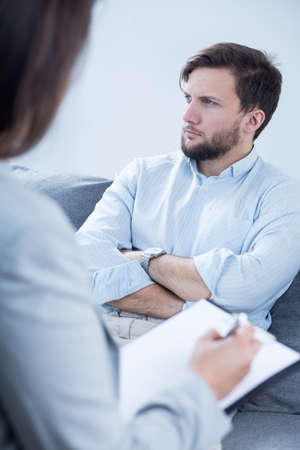 psychiatrist: Image of patient talking with psychiatrist during psychotherapy