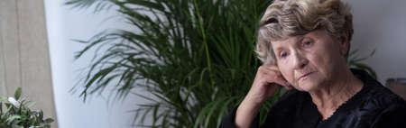 bereaved: Panorama of depressed widow reminiscing her late husband