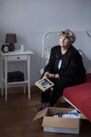 elderly woman: Photo of grieving lonely elderly woman after funeral