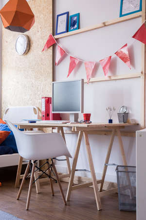 computer room: Photo of simple wooden child desk and comfortable chair Stock Photo