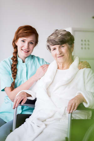 Portrait of female doctor and elderly patient