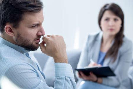 psychiatrist: Photo of female psychiatrist diagnosing her male patient