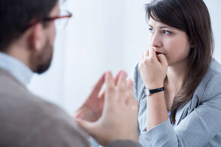 stressed woman: Image of stressed woman during meeting wuth personal coach Stock Photo