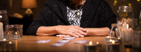 Old fortune teller has lots of clients Stock Photo
