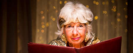 spiritualist: Old fortune teller is reading about magic