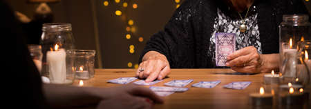 spiritualist: Old fortune teller is dealing cards
