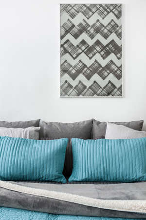 room decoration: Gray and blue cushions on the bed