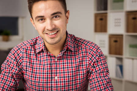 brunets: Young attractive man in shirt at home Stock Photo
