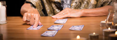 Old fortune teller believes in mystical sorcery Stock Photo