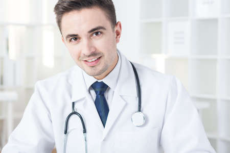 duster: Elegant young physician in medical duster Stock Photo