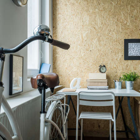 poky: Small room arrangement with place for bicycle Stock Photo