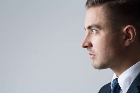 looking ahead: Profile of young handsome businessman looking ahead