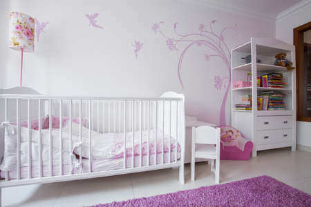 baby nursery: Close-up of white crib in cozy nursery