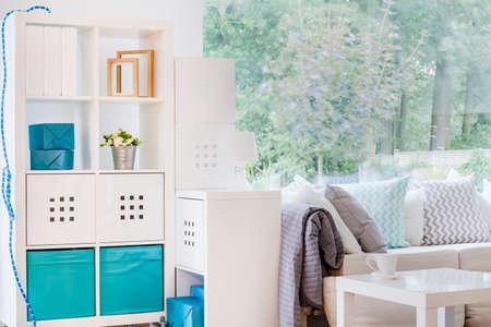 comfort room: Photo of modern white shelving unit in living room Stock Photo