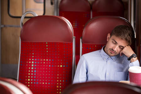 business traveller: Photo of tired commuter going home after work