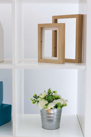 Photo Of White Shelving Unit Flower And Wood Frames Stock Photo ...